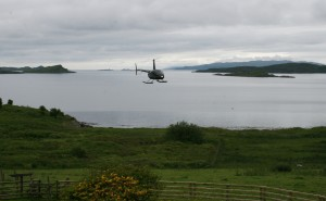 Helicopter approaching Loch Melfort Hotel