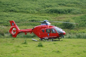 Helicopter in the field at Loch Melfort Hotel
