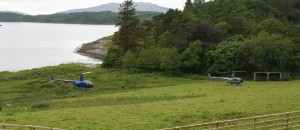 Two helicopters arrive together at Loch Melfort Hotel