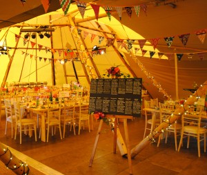 Tipi interior ready for the wedding guests arriving.