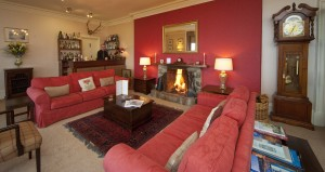 Relax in front of the fire in the Loch Melfort Hotel lounge