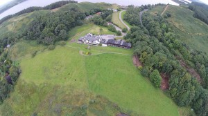 Loch Melfort Hotel from the air including grounds, Highland cattle and duck pond.