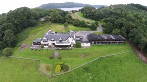 Aerial photo showing Loch Melfort Hotel surrounded by trees