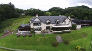 Close up of Loch Melfort Hotel seen from the air